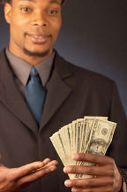 Businessman holding American bills uid
